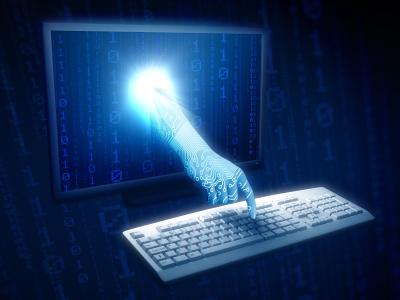 image of hand reaching through computer to keyboard